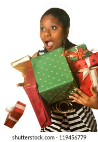 Surprised african girl dropping her christmas presents