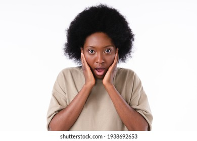 Surprised african-american young girl isolated over white background