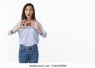 Surprised amazed good-looking middle-aged woman hold gold credit card astonished, open mouth stare camera fascinated recommend excellent bank, astonished good deal, white background