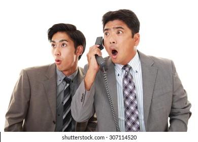 Surprised Asian businessmen