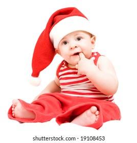 Surprised baby boy in santa claus hat on white background