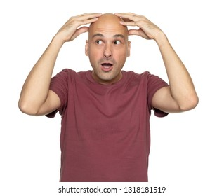 surprised bald man holds his head in hands and looking aside. Isolated
