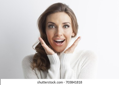 Surprised beautiful woman in sweater, winter christmas gift concept