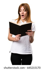 Surprised Beautiful young girl reading book