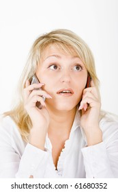 surprised blonde with two mobile phones on a white background