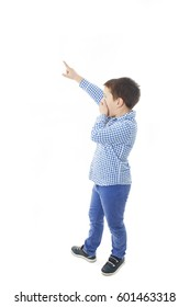 Surprised boy pointing, looking up. Isolated on white background