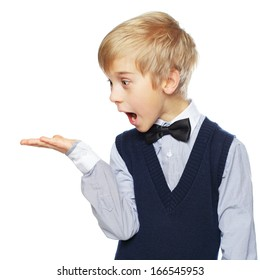 Surprised boy showing something and looking at hand