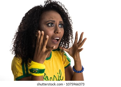 Surprised. Brazil supporter. Brazilian woman fan celebrating on soccer / footbal match isolated on white background. Brazil colors.