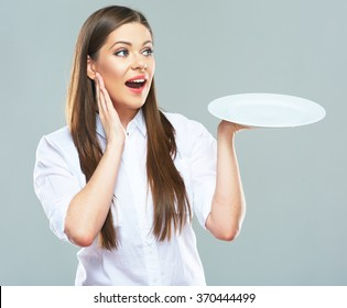Surprised Business woman  hold empty white plate. Studio isolated portrait of young business woman.