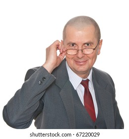 A surprised businessman with eyeglasses isolated on white.