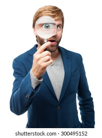 surprised businessman with magnifying glass