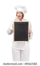 surprised chef or cook woman holding empty blackboard for your text isolated on white background. advertisement blank board. your text here. restaurant, dieting and cooking food concept