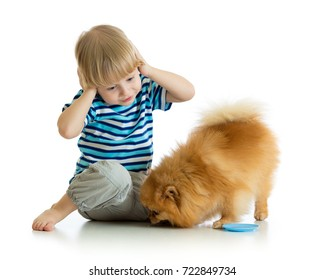 surprised child boy with dog isolated on white