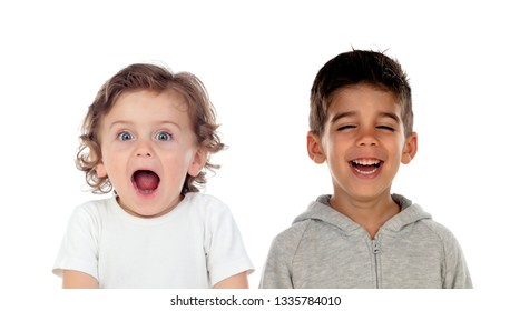 Surprised child and his friend laughing isolated on a white background