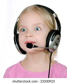 Surprised child wearing headset