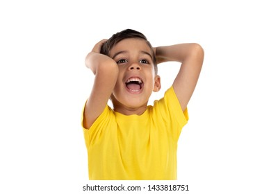 Surprised child with yellow t-shirt isolated on a white background