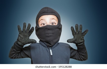 Surprised comic burglar stopped and take his hands up