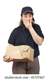 Surprised courier woman holding a damaged package isolated on white background