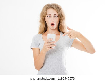 surprised, cute sexy woman points finger at mobile phone isolated on white background, copy space