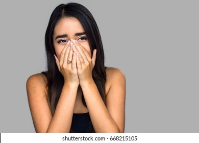 Surprised embarrassed expression woman covers her face shy shocked emotional