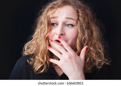 Surprised excited woman isolated on black background