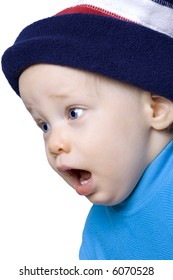Surprised expression on baby boy in winter hat