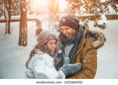 surprised falling snow couple laughing
