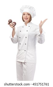 surprised female chef, cook or baker holding avocado isolated on white background. dieting, cooking and food concept
