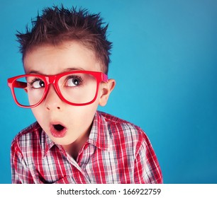 Surprised five years old boy wearing glasses