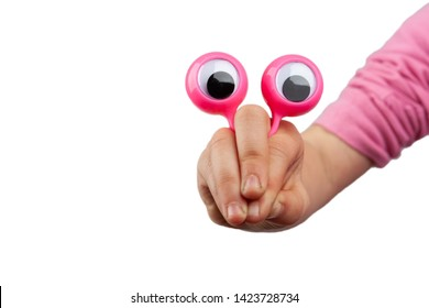Surprised funny cartoonish face made with child hand and googly eyes isolated on white background with copy space