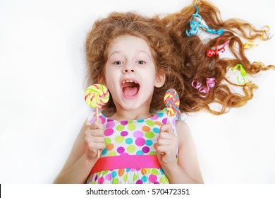 Surprised funny girl  hold candy lollipop. Healthy lifestyle concept.