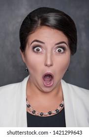 Surprised funny woman on chalkboard blackboard background