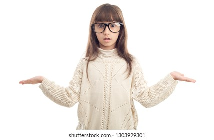 Surprised girl. Child in glasses with a surprised facial expression, standing on a white background.