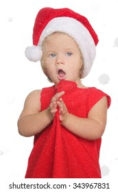 surprised girl in christmas cap in snow isolated on white