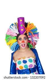 Surprised girl clown with a big colorful wig isolated on white background