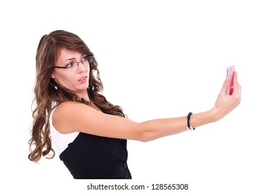 Surprised girl holding and looking to mobile phone