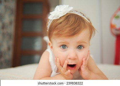 surprised girl with opened mouth lying in bed