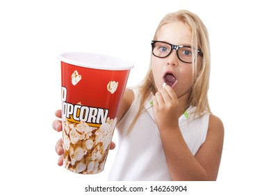 surprised girl with popcorn cup