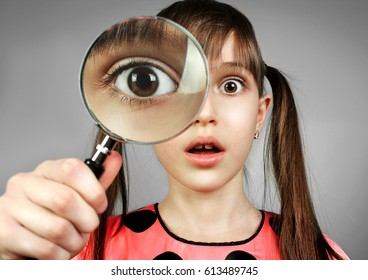 surprised girl, searching  with magnifying glass