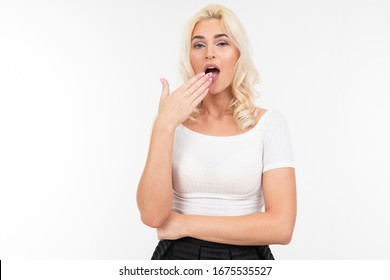 surprised girl in a white t-shirt on a white background with copy space