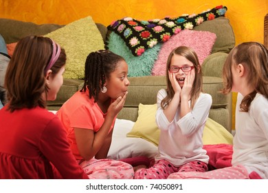Surprised group of little girls at a sleepover