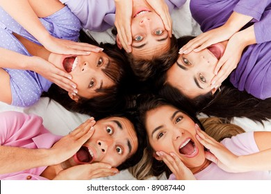 Surprised group of people lying on the floor