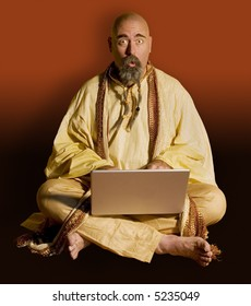 Surprised guru with a laptop computer.