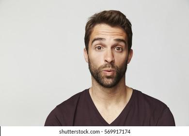 Surprised guy in studio, portrait