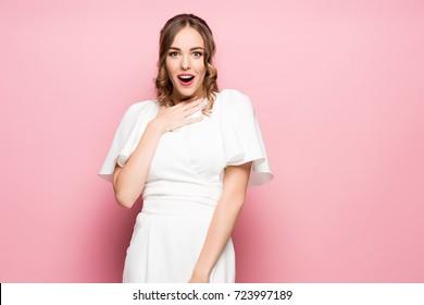 Surprised happy beautiful woman looking sideways in excitement.