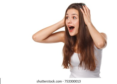 Surprised happy beautiful woman looking sideways in excitement, isolated