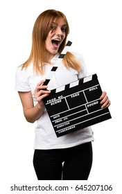 Surprised Happy Beautiful young girl holding a clapperboard