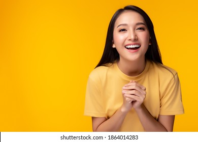 Surprised happy beauty asian woman looking camera in excitement with happy and smile face. Expressive facial expressions. Beautiful girl act like a satisfied product Isolated on yellow background