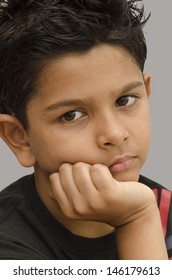 surprised indian eight year old boy
