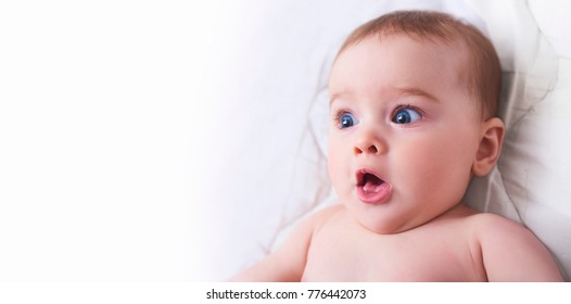 Surprised kid. Child's eyes widened and mouth opened in amazement.
